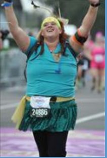 Taryn crossing the runDisney Princess Half Marathon finish line. Fitzness.com